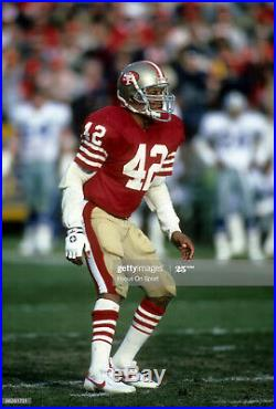 MID-80'S RONNIE LOTT SAN FRANCISCO 49ERS SIGNED GAME USED JERSEY WithTEAM REPAIRS
